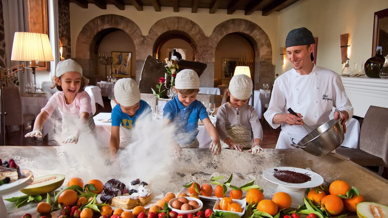 Children learning to cook at La Residencia