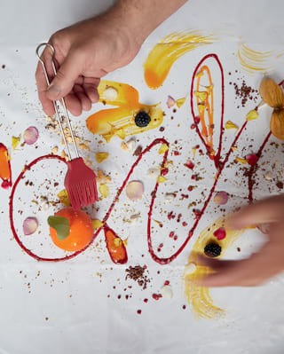 Birds-eye-view of a dessert dish presented in the style of modern artwork