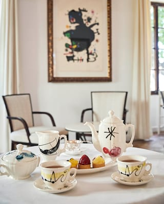 Close-up of a Miró porcelain tea set served with afternoon tea cakes