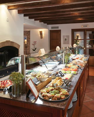 Close-up of a lunch buffet bar topped with an assortment of classic Spanish dishes