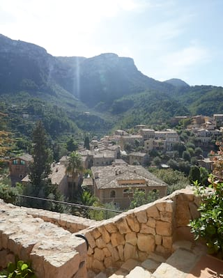 View over a stone-built wall of a Spanish mountain valley village of stone houses