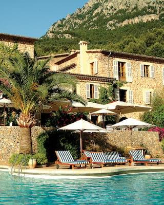 La Residencia pool and hotel under blue skies