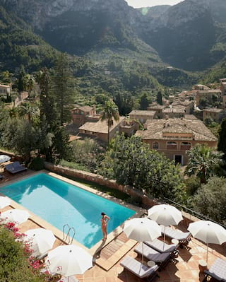 Aerial view of a hotel pool overlooking the Tramuntana mountains