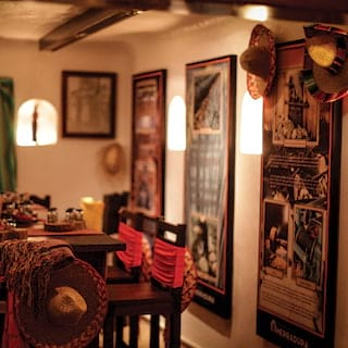 Low-light image of a traditional Mexican cantina-style private table