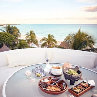 Open-air private circular table, overlooking the Riviera Maya