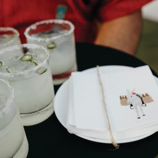 Close-up view of staff carrying a tray of margarita cocktails