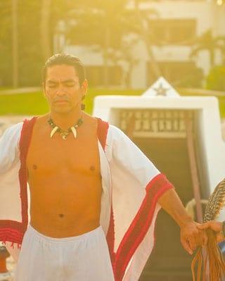 Mayan shaman conducting a beach Temazcal ceremony