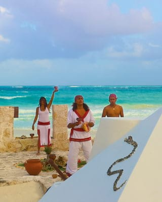 Shaman presenting a traditional Mayan ceremony on a beach