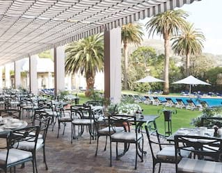 Poolside dining at Belmond Mount Nelson Hotel