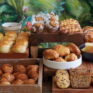 Breakfast buffet stand with a selection of pastries and croissants