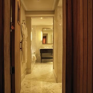 View through a marble corridor of a bathroom beyond