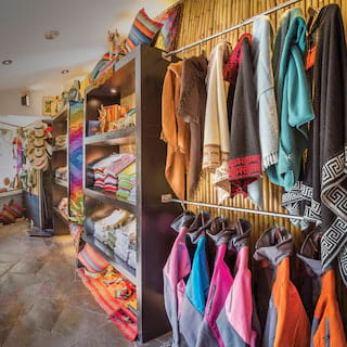 Small boutique shelves brimming with colourful Peruvian alpaca wool clothes