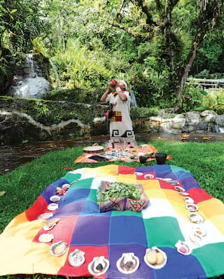 Man in traditional Peruvian dress calling out in a garden ritual