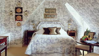 Spacious and light filled attic room decorated entirely with French-blue toile