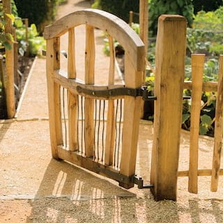Charming oak gate leading to a vegetable garden beyond