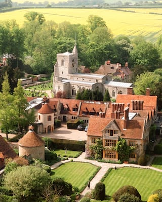 Aerial view of Le Manoir aux Quat'Saisons on a sunny day