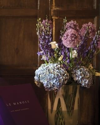 Close-up of a bouquet of purple and blue peonies, lupins and roses