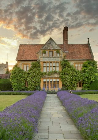 Lavender-lined garden path of a country manor house hotel