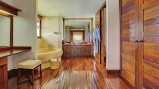 Spacious bathroom with polished bamboo floors and cabinets