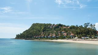 Beach villas on a jungle-coated hillside overlooking the Gulf of Thailand