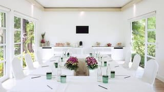 Bright and airy meeting room with U-shaped banquet table