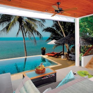 Beach front villa open-air lounge area overlooking a private pool and beach