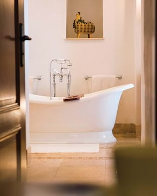 Close-up of a standalone bathtub view through a doorway
