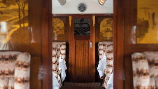 Train carriage with French-polished wall panels and a woodland marquetry design
