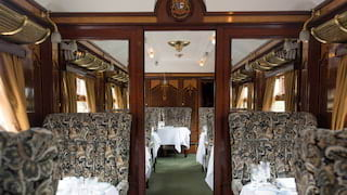Grand vintage train carriage with liberty print furnishings and gleaming brass details
