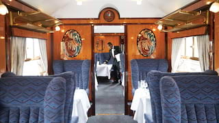 View through the aisle of an original Pullman carriage with gleaming wood panels