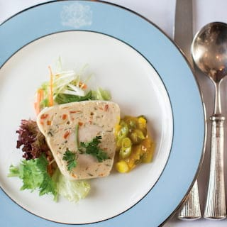 Birds-eye-view of a crab terrine served with a radicchio salad