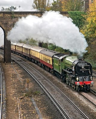Belmond British Pullman being hauled by steam locomotive