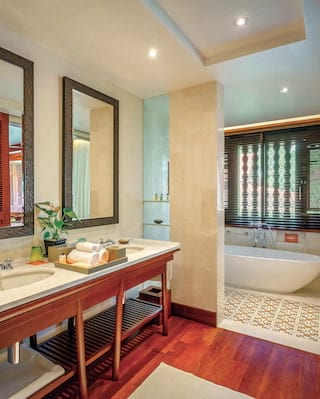 Spacious modern bathroom with bamboo details and his and hers sinks