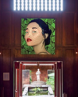 Large contemporary portrait of a Cambodian woman in a wood-panelled room