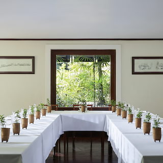 U-shaped banquet tables in a light and airy room set for a meeting