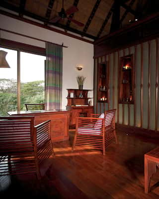 Spa reception with high ceiling and polished teak floors and furnishings
