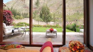 View of Sacred Valley through the patio doors of a luxurious hotel room