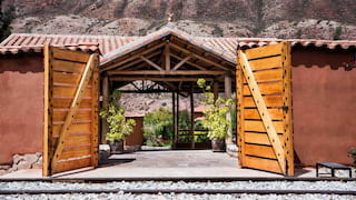Two barn doors opening to a train platform with a terracotta tiled roof