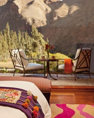 Two ironwork armchairs on an outdoor patio overlooking Sacred Valley