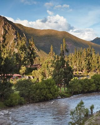 Tranquil Peruvian valley with a winding river running through the center