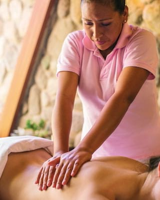 Close-up of a lady receiving a back massage