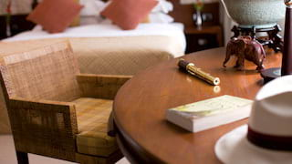 Close-up of a book and brass telescope on a writing desk in a cabin suite