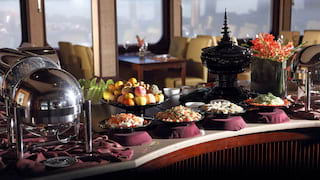 Breakfast buffet with fresh fruit and hot food in bain-maries in a restaurant
