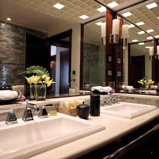 Spacious cruise ship cabin bathroom with 'his and hers' porcelain sinks