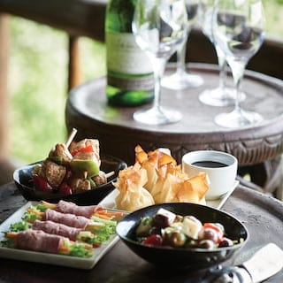 Close-up of a circular table with an assortment of canapés and snacks on top