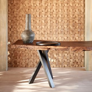Clay vase on a side console table made of natural sun-bleached wood