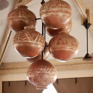 Close-up of hanging African-print clay pots in a pendant style art-piece