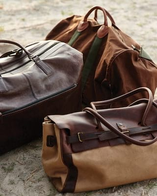 Close-up of luxurious leather and khaki camping luggage