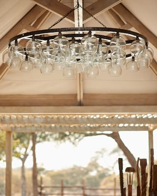 Close-up of a contemporary chandelier with a collection of glass bowl bulbs