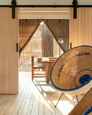Contemporary bowl shaped rattan chair in a light and airy lodge lounge